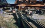 "<span class=""caption-caption"">During construction, the north end of the rail bridge was moved on rollers and pushed by tractors, Indooroopilly</span>, 1957. <br />Slide, collection of <span class=""caption-contributor"">Oswald  Endacott</span>."
