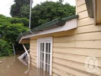 "<span class=""caption-caption"">Flood water rises to the windows of this Graceville house, 13 January 2011</span>. <br />Digital image, collection of <span class=""caption-contributor"">Rachel Bastin</span>."