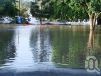 "<span class=""caption-caption"">Rising flood waters, from Montague Road, West End, January 2011</span>. <br />Digital image, collection of <span class=""caption-contributor"">Liz Jordan</span>."