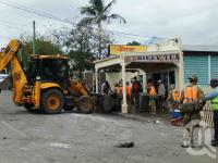 """<span class=""""caption-caption"""">Army personnel assist flood clean up, Convenience Store, Hoogley Street, West End, January 2011</span>. <br />Digital image, collection of <span class=""""caption-contributor"""">Liz Jordan</span>."""