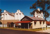 "<span class=""caption-caption"">Old shire office and peanut silos</span>, 2003. <br />Photograph, collection of <span class=""caption-contributor"">John Young</span>."