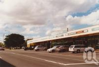 "<span class=""caption-caption"">Eagle Junction shops</span>, 2003. <br />Photograph, collection of <span class=""caption-contributor"">John Young</span>."