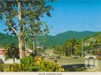 """<span class=""""caption-caption"""">Shute Harbour Road, Airlie Beach</span>, c1985. <br />Postcard folder by <span class=""""caption-publisher"""">Peer Productions</span>, collection of <span class=""""caption-contributor"""">Centre for the Government of Queensland</span>."""