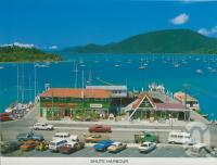 "<span class=""caption-caption"">Shute Harbour Airlie Beach</span>, c1985. <br />Postcard folder by <span class=""caption-publisher"">Peer Productions</span>, collection of <span class=""caption-contributor"">Centre for the Government of Queensland</span>."