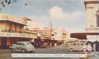 "<span class=""caption-caption"">Kent Street from Town Hall Corner, Maryborough</span>, c1950. <br />Postcard folder by <span class=""caption-publisher"">Murray Views Pty Ltd</span>, collection of <span class=""caption-contributor"">Centre for the Government of Queensland</span>."
