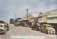 """<span class=""""caption-caption"""">Shopping centre, Pialba, Hervey Bay</span>, c1950. <br />Postcard folder by <span class=""""caption-publisher"""">Murray Views Pty Ltd</span>, collection of <span class=""""caption-contributor"""">Centre for the Government of Queensland</span>."""