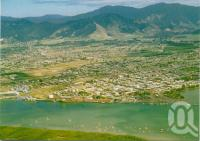 """<span class=""""caption-caption"""">Aerial View of Cairns</span>, c1970. <br />Postcard by <span class=""""caption-publisher"""">Peer Productions</span>, collection of <span class=""""caption-contributor"""">Centre for the Government of Queensland</span>."""