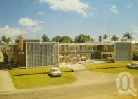 """<span class=""""caption-caption"""">Lyons Motel, Abbott Street, Cairns</span>, c1964. <br />Postcard by <span class=""""caption-publisher"""">GK Bolton</span>, collection of <span class=""""caption-contributor"""">Centre for the Government of Queensland</span>."""