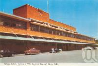 """<span class=""""caption-caption"""">Railway Station, terminal of the Sunshine Express, Cairns</span>, c1962. <br />Postcard folder by <span class=""""caption-publisher"""">Murray Views Pty Ltd</span>, collection of <span class=""""caption-contributor"""">Centre for the Government of Queensland</span>."""