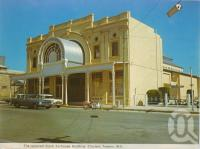 "<span class=""caption-caption"">Stock Exchange Building, Charters Towers</span>, c1972. <br />Postcard folder by <span class=""caption-publisher"">Murray Views Pty Ltd</span>, collection of <span class=""caption-contributor"">Centre for the Government of Queensland</span>."
