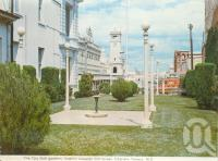 "<span class=""caption-caption"">The city gardens looking towards Gill Street, Charters Towers</span>, c1972. <br />Postcard folder by <span class=""caption-publisher"">Murray Views Pty Ltd</span>, collection of <span class=""caption-contributor"">Centre for the Government of Queensland</span>."