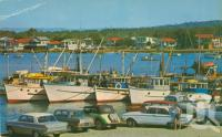 "<span class=""caption-caption"">The Mooloolah River at this point provides safe anchorage for prawn trawlers and pleasure craft</span>, c1964. <br />Postcard by <span class=""caption-publisher"">Bernard Kuskopf</span>, collection of <span class=""caption-contributor"">Centre for the Government of Queensland</span>."