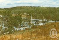 "<span class=""caption-caption"">View from the Palmer River Café</span>, c1964. <br />Postcard folder by <span class=""caption-publisher"">Unknown Publisher</span>, collection of <span class=""caption-contributor"">Centre for the Government of Queensland</span>."