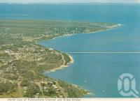"<span class=""caption-caption"">Aerial view of Pumicestone Channel and Bribie bridge</span>, 1975. <br />Postcard folder by <span class=""caption-publisher"">Bernard Kuskopf</span>, collection of <span class=""caption-contributor"">Centre for the Government of Queensland</span>."