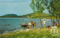 "<span class=""caption-caption"">Water ski-ing on the lake at the causeway, Emu Park</span>, c1975. <br />Postcard by <span class=""caption-publisher"">Murray Views Pty Ltd</span>, collection of <span class=""caption-contributor"">Centre for the Government of Queensland</span>."