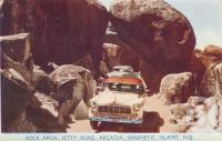 "<span class=""caption-caption"">Rock arch, Jetty Road, Arcadia, Magnetic Island</span>, c1960. <br />Postcard folder by <span class=""caption-publisher"">Murray Views Pty Ltd</span>, collection of <span class=""caption-contributor"">Centre for the Government of Queensland</span>."