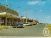 "<span class=""caption-caption"">Moura shopping centre, Dawson-Callide Valley</span>, c1972. <br />Postcard folder by <span class=""caption-publisher"">Murray Views Pty Ltd</span>, collection of <span class=""caption-contributor"">Centre for the Government of Queensland</span>."