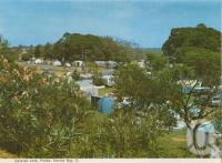 """<span class=""""caption-caption"""">Caravan park, Pialba, Hervey Bay</span>, c1970. <br />Postcard folder by <span class=""""caption-publisher"""">Murray Views Pty Ltd</span>, collection of <span class=""""caption-contributor"""">Centre for the Government of Queensland</span>."""
