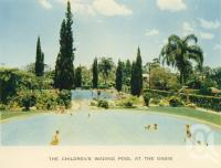 "<span class=""caption-caption"">The children's wading pool, the Oasis</span>, c1960. <br />Postcard folder by <span class=""caption-publisher"">Sydney G Hughes Pty Ltd</span>, collection of <span class=""caption-contributor"">John Young</span>."