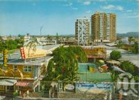 """<span class=""""caption-caption"""">The Beachcomber, on Cavill Avenue with 'Paradise Towers' and 'Kinkabool' in background</span>, c1961. <br />Postcard folder by <span class=""""caption-publisher"""">Kruger</span>, collection of <span class=""""caption-contributor"""">John Young</span>."""