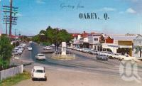 "<span class=""caption-caption"">The main street, Oakey</span>, c1962. <br />Postcard by <span class=""caption-publisher"">Samuel Lee & Co Pty Ltd</span>, collection of <span class=""caption-contributor"">John Young</span>."