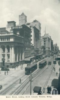 "<span class=""caption-caption"">Queen Street looking south towards Victoria Bridge, Brisbane</span>, c1938. <br />Postcard folder by <span class=""caption-publisher"">Sydney G Hughes Pty Ltd</span>, collection of <span class=""caption-contributor"">Centre for the Government of Queensland</span>."