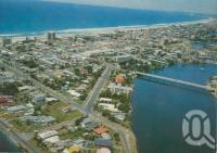"""<span class=""""caption-caption"""">Aerial view, Surfers Paradise</span>, c1970. <br />Postcard by <span class=""""caption-publisher"""">Kibble Pty Ltd</span>, collection of <span class=""""caption-contributor"""">Centre for the Government of Queensland</span>."""