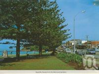 """<span class=""""caption-caption"""">Redcliffe Parade from the memorial gardens</span>, c1965. <br />Postcard by <span class=""""caption-publisher"""">Murray Views Pty Ltd</span>, collection of <span class=""""caption-contributor"""">Centre for the Government of Queensland</span>."""