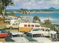 "<span class=""caption-caption"">Board riders gather at entrance to the Noosa National Park</span>, c1963. <br />Postcard folder by <span class=""caption-publisher"">Bernard Kuskopf</span>, collection of <span class=""caption-contributor"">Centre for the Government of Queensland</span>."