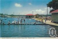 "<span class=""caption-caption"">Donella bridge and swimming enclosure, Noosa River, Tewantin</span>, c1959. <br />Postcard folder by <span class=""caption-publisher"">Murray Views Pty Ltd</span>, collection of <span class=""caption-contributor"">Centre for the Government of Queensland</span>."