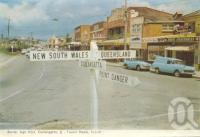 """<span class=""""caption-caption"""">Border sign Coolangatta-Tweed Heads</span>, 1962. <br />Postcard folder by <span class=""""caption-publisher"""">Murray Views Pty Ltd</span>, collection of <span class=""""caption-contributor"""">Centre for the Government of Queensland</span>."""
