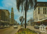 "<span class=""caption-caption"">Flinders Street, Townsville</span>, 1971. <br />Postcard by <span class=""caption-publisher"">Murray Views Pty Ltd</span>, collection of <span class=""caption-contributor"">Centre for the Government of Queensland</span>."