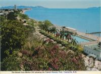 "<span class=""caption-caption"">The Strand from Melton Hill showing the Tobruk Olympic Pool, Townsville</span>, c1970. <br />Postcard folder by <span class=""caption-publisher"">Murray Views Pty Ltd</span>, collection of <span class=""caption-contributor"">Centre for the Government of Queensland</span>."