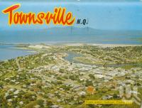 "<span class=""caption-caption"">Townsville from scenic lookout, Castle Hill</span>, 1973. <br />Postcard folder by <span class=""caption-publisher"">Murray Views Pty Ltd</span>, collection of <span class=""caption-contributor"">Centre for the Government of Queensland</span>."
