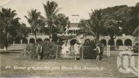 """<span class=""""caption-caption"""">Glimpse of Queen's Hotel from Strand Park, Townsville</span>, c1928. <br />Postcard by <span class=""""caption-publisher"""">Unknown Publisher</span>, collection of <span class=""""caption-contributor"""">Centre for the Government of Queensland</span>."""