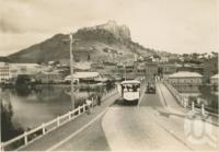 """<span class=""""caption-caption"""">Victoria Bridge, Townsville</span>, c1928. <br />Postcard by <span class=""""caption-publisher"""">Unknown Publisher</span>, collection of <span class=""""caption-contributor"""">Centre for the Government of Queensland</span>."""