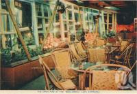 "<span class=""caption-caption"">The open fire at the Boolarong Café Espresso, Alexandra Headland</span>, c1958. <br />Postcard folder by <span class=""caption-publisher"">Sydney G Hughes Pty Ltd</span>, collection of <span class=""caption-contributor"">Centre for the Government of Queensland</span>."