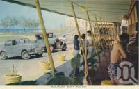 "<span class=""caption-caption"">Boolarong Beach Milk Bar, Alexandra Headland</span>, c1958. <br />Postcard folder by <span class=""caption-publisher"">Sydney G Hughes Pty Ltd</span>, collection of <span class=""caption-contributor"">Centre for the Government of Queensland</span>."