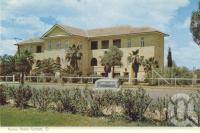 """<span class=""""caption-caption"""">Roma State School</span>, c1962. <br />Postcard folder by <span class=""""caption-publisher"""">Murray Views Pty Ltd</span>, collection of <span class=""""caption-contributor"""">Centre for the Government of Queensland</span>."""