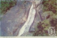 "<span class=""caption-caption"">Tully Falls near Ravenshoe</span>, c1960. <br />Postcard folder by <span class=""caption-publisher"">Murray Views Pty Ltd</span>, collection of <span class=""caption-contributor"">Centre for the Government of Queensland</span>."