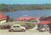"""<span class=""""caption-caption"""">Water ski-ing Lake Barrine, showing dinng hall and tea room, Yungaburra</span>, c1960. <br />Postcard folder by <span class=""""caption-publisher"""">Murray Views Pty Ltd</span>, collection of <span class=""""caption-contributor"""">Centre for the Government of Queensland</span>."""