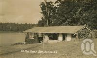 """<span class=""""caption-caption"""">Tea rooms, Lake Barrine, Yungaburra</span>, c1938. <br />Postcard by <span class=""""caption-publisher"""">Murray Studios Pty Ltd</span>, collection of <span class=""""caption-contributor"""">Centre for the Government of Queensland MS</span>."""