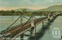 "<span class=""caption-caption"">Fitzroy Bridge, Rockhampton</span>, 1911. <br />Postcard by <span class=""caption-publisher"">Coloured Shell Series</span>, collection of <span class=""caption-contributor"">Centre for the Government of Queensland</span>."
