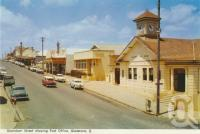 "<span class=""caption-caption"">Goondoon Street, showing Post Office, Gladstone</span>, c1960. <br />Postcard folder by <span class=""caption-publisher"">Murray Views Pty Ltd</span>, collection of <span class=""caption-contributor"">Centre for the Government of Queensland</span>."
