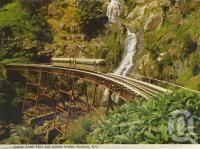 "<span class=""caption-caption"">Stoney Creek Falls and railway bridge, Kuranda</span>, c1964. <br />Postcard folder by <span class=""caption-publisher"">Murray Views Pty Ltd</span>, collection of <span class=""caption-contributor"">Centre for the Government of Queensland</span>."
