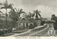 "<span class=""caption-caption"">Railway Station, Kuranda</span>, 1938. <br />Postcard folder by <span class=""caption-publisher"">Murray Views Pty Ltd</span>, collection of <span class=""caption-contributor"">Centre for the Government of Queensland</span>."