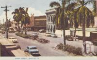 "<span class=""caption-caption"">Wood Street, Mackay</span>, c1956. <br />Postcard folder by <span class=""caption-publisher"">Murray Views Pty Ltd</span>, collection of <span class=""caption-contributor"">Centre for the Government of Queensland</span>."