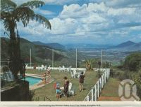 """<span class=""""caption-caption"""">Overlooking the Pioneer Valley from the Chalet, Eungella</span>, c1976. <br />Postcard folder by <span class=""""caption-publisher"""">Murray Views Pty Ltd</span>, collection of <span class=""""caption-contributor"""">Centre for the Government of Queensland</span>."""
