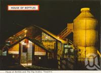 "<span class=""caption-caption"">House of Bottles and The Big Stubby, Tewantin</span>, c1962. <br />Postcard folder by <span class=""caption-publisher"">Bernard Kuskopf</span>, collection of <span class=""caption-contributor"">Centre for the Government of Queensland</span>."