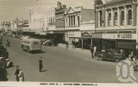 "<span class=""caption-caption"">Ruthven Street, Toowoomba</span>, c1950. <br />Postcard by <span class=""caption-publisher"">Murray Views Pty Ltd</span>, collection of <span class=""caption-contributor"">Centre for the Government of Queensland</span>."